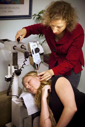 Dr Sheehan adjusts Atlas Orthogonal